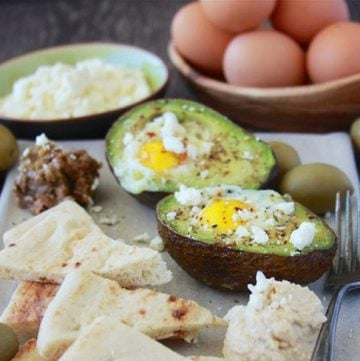 Mediterranean Baked Eggs in Avocado make breakfast Egg-xtra special! #HappyHenHappyEgg #FreeestFreeRange #AD