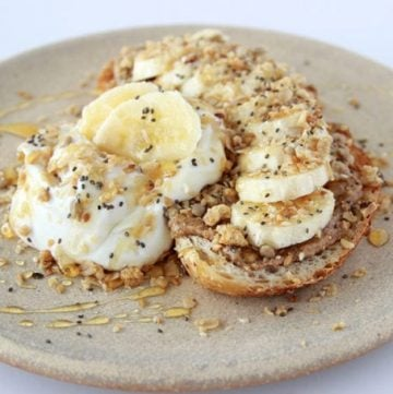 Banana, Almond Butter, Granola Toast is SO flavorful and packed with all kinds of delicious nutrition! www.cookingwithruthie.com