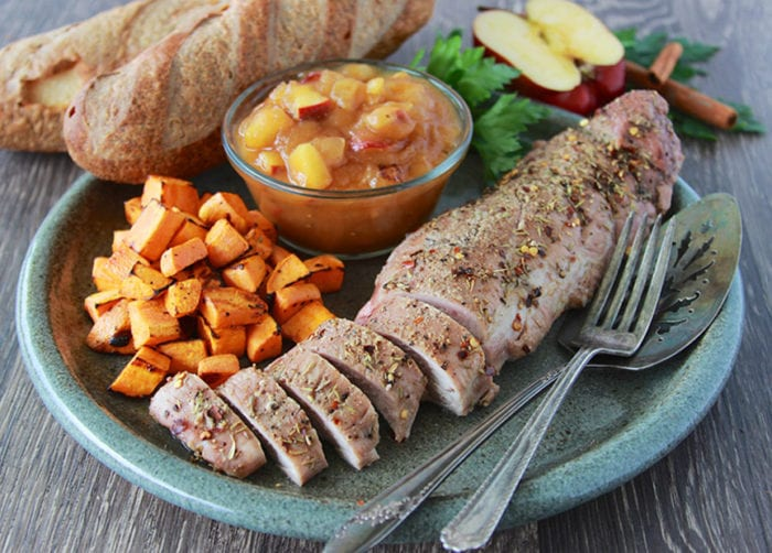 Apple Butter Pork Loin with Roasted Sweet Potatoes is one of our favorite autumn dinners! www.cookingwithruthie.com