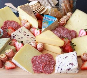 Cheese and Charcuterie Board with Crackers is the appetizer everyone always LOVES at a gathering! www.cookingwithruthie.com