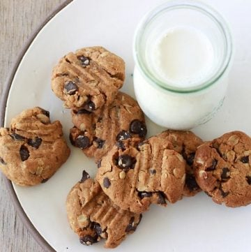 Gluten-free Dark Chocolate Peanut Butter Cookies are simply 5 ingredients then into the oven for crisp, flaky, and perfect peanut butter cookies! by cookingwithruthie.com