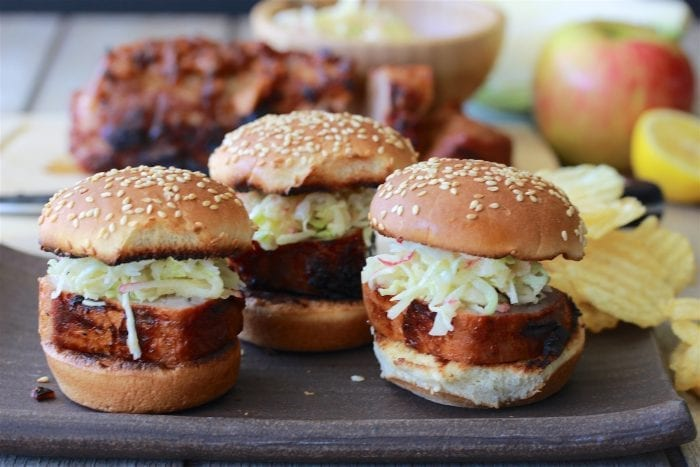 Applewood Pork Sliders with Apple Slaw Recipe are perfect for summer backyard grilling parties! by cookingwithruthie.com