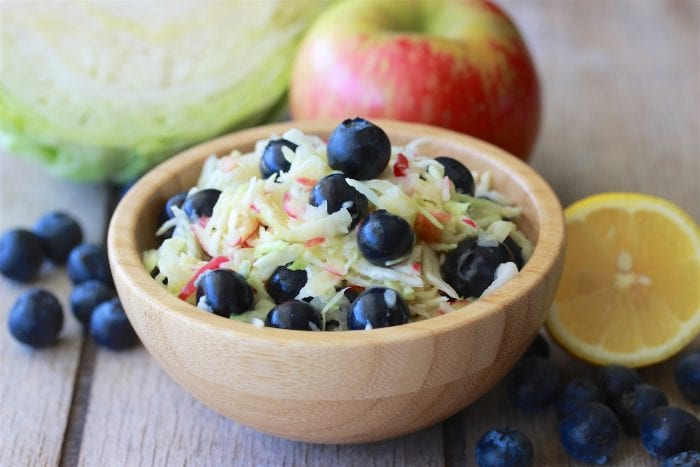 Blueberry Apple Coleslaw is a flavorful summer salad to go with your next BBQ! by cookingwithruthie.com