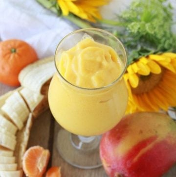 Orange Mango Banana Protein Smoothie Recipe is healthy and refreshing anytime of day! Enjoy! by cookingwithruthie.com