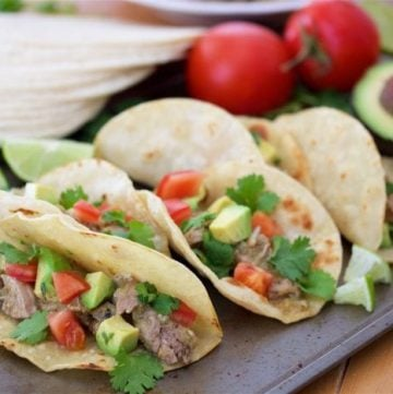 Tomatillo Pulled Pork Taco Recipe are tex-mex heaven with only 6 ingredients and your slow cooker! by cookingwithruthie.com
