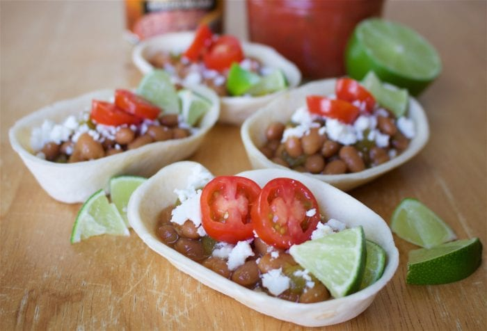 Green Chili Beans and Cojita Mini Taco Bowls Recipe are a quick and easy lunch or dinner recipe for the whole family! by cookingwithruthie.com