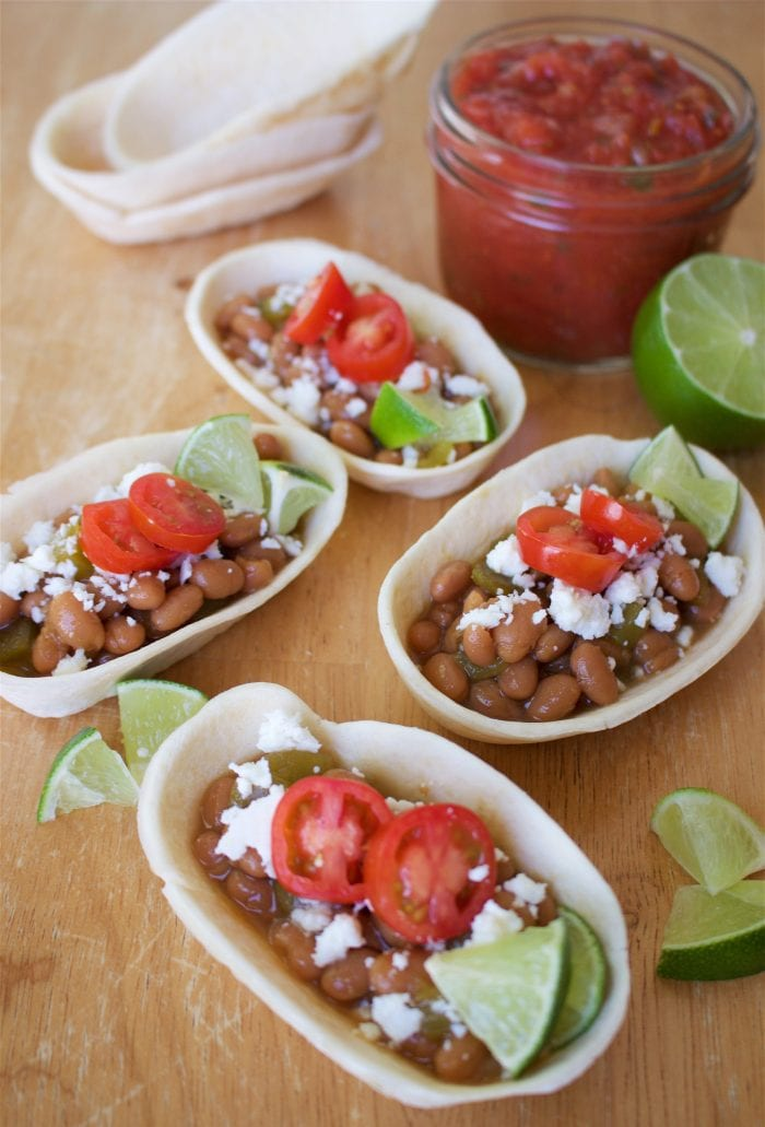 Green Chili Beans and Cotija Mini Taco Bowls Recipe are a quick and easy lunch or dinner recipe for the whole family! by cookingwithruthie.com