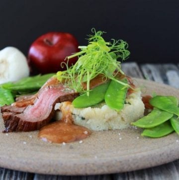 Guajillo Flank Steak, Scallion Grits, & Peas are a savory delight that will be sure to impress all your dinner guests! by cookingwithruthie.com