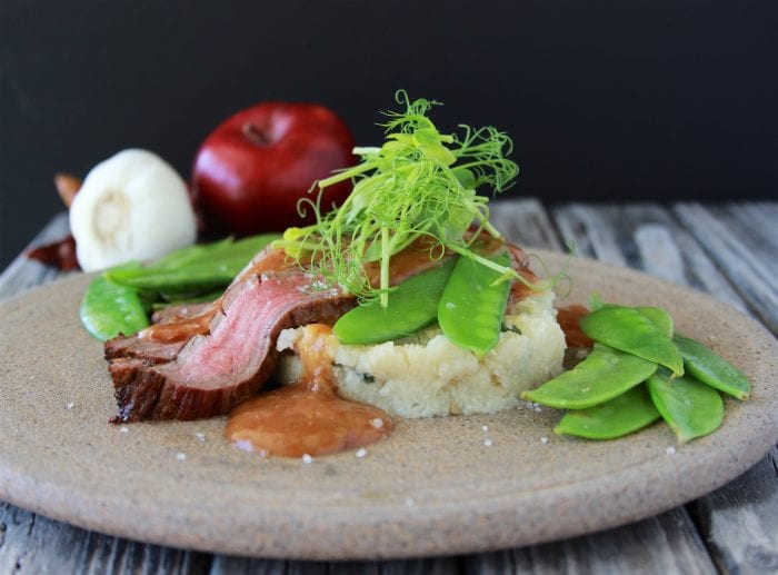 Guajillo Flank Steak, Scallion Grits, and Peas is a going to wow all your dinner guests! by cookingwithruthie.com