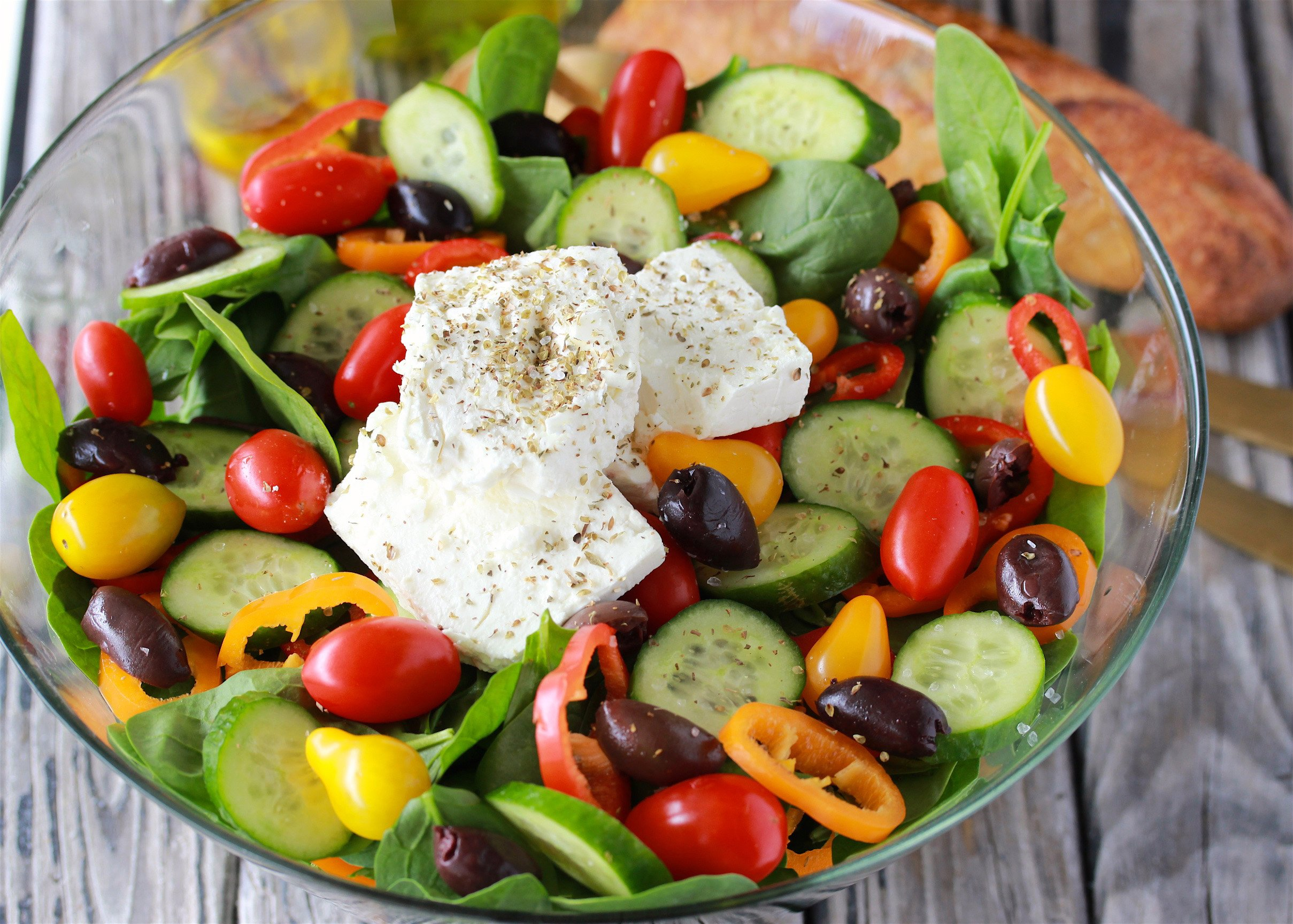 Mediterranean Spinach Salad Recipe is a colorful salad to feed a crowd! by cookingwithruthie.com