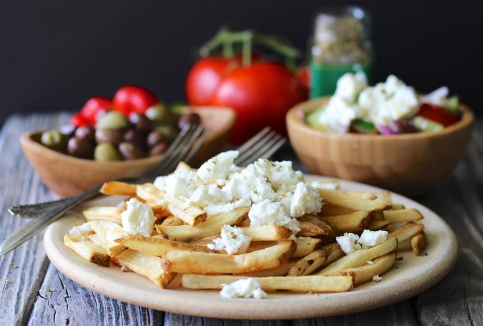 Greek Baked Fries with Feta & Oregano Recipe combines our family favorite baked fries recipe with a little flavor spin from Greece! by cookingwithruthie.com