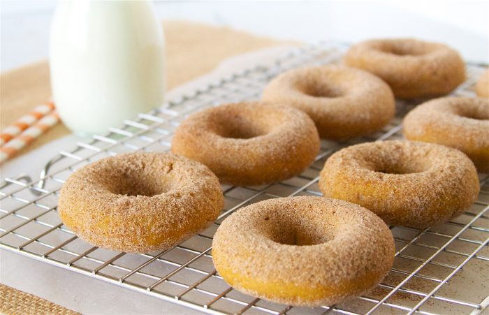 Our Skinny Baked Pumpkin Donuts Recipe will be your new favorite autumn baking recipe! by cookingwithruthie.com