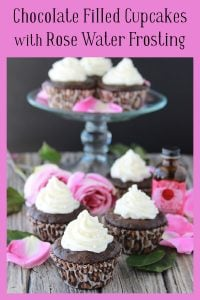 Chocolate Filled Cupcakes with Rose Water Frosting a dainty little cake with a hint of rose on www.cookingwithruthie.com