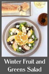 Our Winter Fruit and Greens Salad Recipe is a lovely combination of fruits and vegetables to keep you healthy and happy this winter! Our winter salad has mixed greens, apples, oranges, mangoes, chevre cheese, sunflower seeds, and a drizzle of olive oil. Oh, and if you prefer an added flavor pop, then a little drizzle of balsamic vinegar will do the trick!    cookingwithruthie.com #saladrecipe #wintersalad