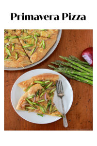 Primavera Pizza Recipe | Our primavera pizza is a delightful spring inspired dinner that is made with fresh asparagus, red onion, edam and parmesan cheese, olive oil, and whole wheat pizza dough. || cookingwithruthie.com #springrecipe #springpizza #pizzarecipe