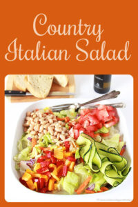 Today's Country Italian Salad Recipe is as beautiful as it is nutritious–you'll love every bite! Our country salad has crisp greens, white beans, tomatoes, peppers, shaved cucumber, and parmesan cheese. Enjoy! cookingwithruthie.com #saladrecipe #healthyrecipe